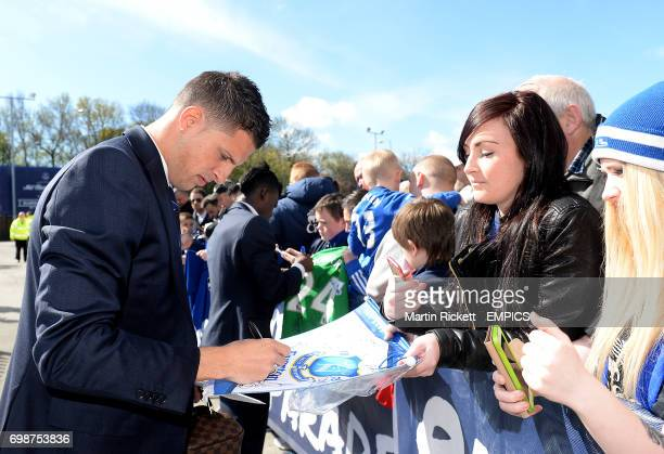 Everton's Kevin Mirallas signs autographs for fans outside Goodison Park