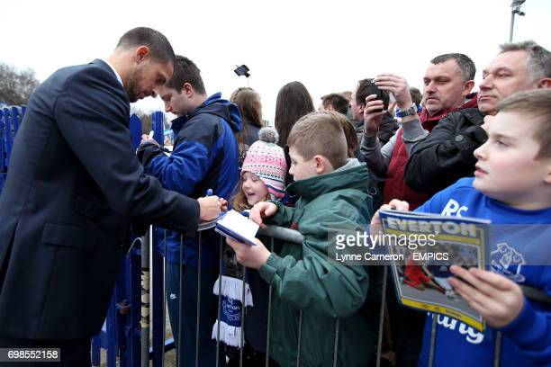 Everton's Kevin Mirallas signs autographs with fans before the game