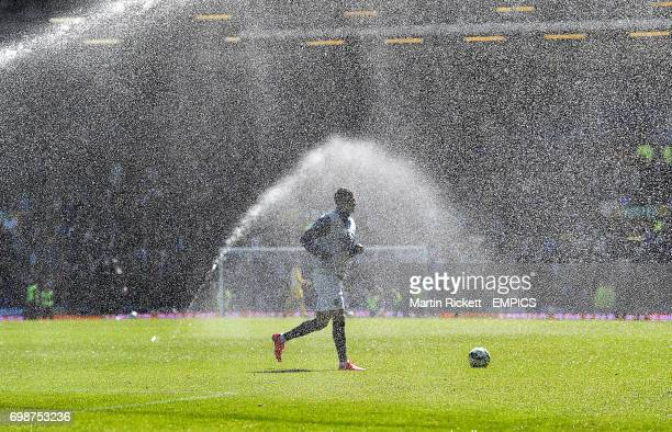 Everton's Kevin Mirallas warms up under the sprinklers