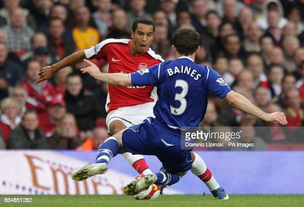 Everton's Leighton Baines and Arsenal's Theo Walcott battle for the ball