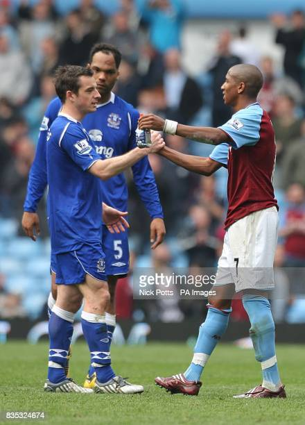 Everton's Leighton Baines and Aston Villa's Ashley Young shake hands after the final whistle
