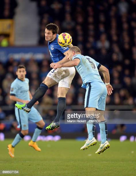 Everton's Leighton Baines and Manchester City's Pablo Zabaleta battle for the ball