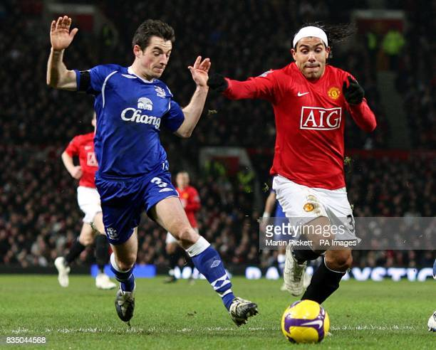 Everton's Leighton Baines and Manchester United's Carlos Tevez battle for the ball