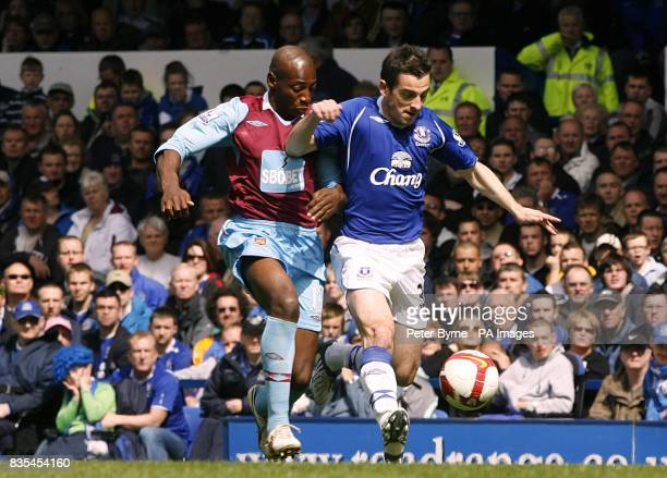 Everton's Leighton Baines and West Ham United's Luis Boa Morte battle for the ball