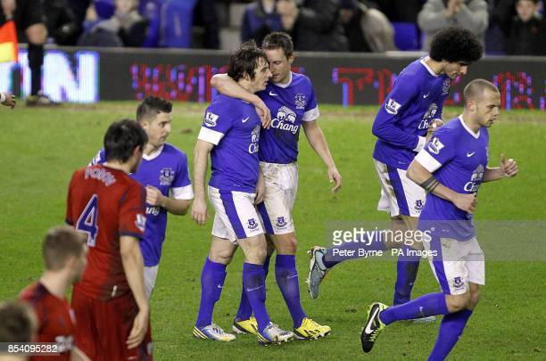 Everton's Leighton Baines celebrates scoring their second goal from the penalty spot with teammate Phil Jagielka