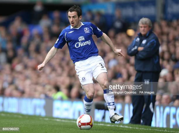 Everton's Leighton Baines in action watched by Wigan Athletic manager Steve Bruce