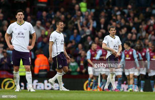 Everton's Leighton Baines Phil Jagielka and Gareth Barry look dejected after conceding the third goal