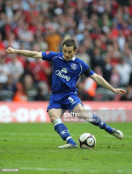 Everton's Leighton Baines scores his penalty in the shootout