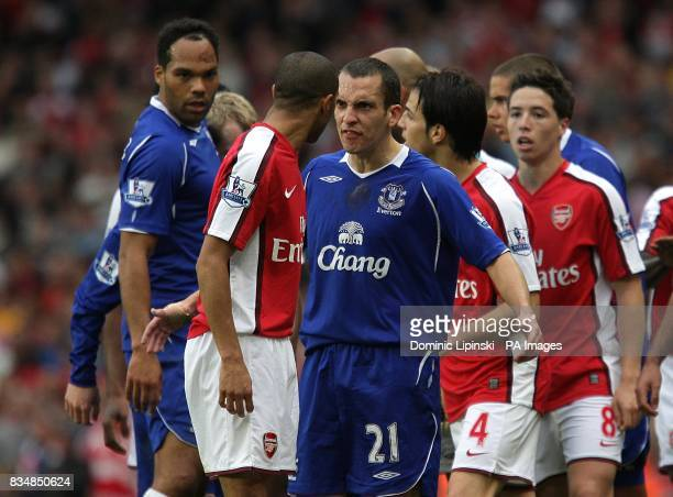 Everton's Leon Osman and Arsenal's Gael Clichy square up to each other