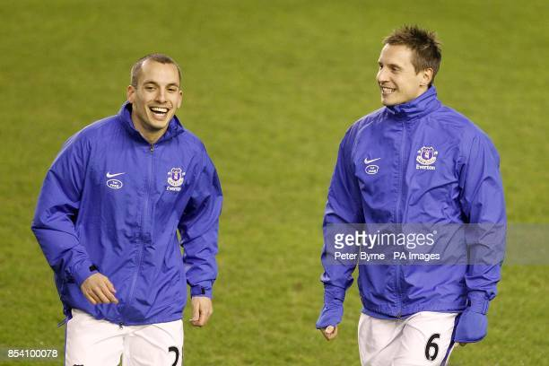 Everton's Leon Osman and Phil Jagielka share a joke before the game