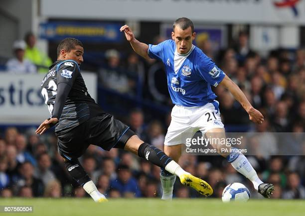 Everton's Leon Osman and Portsmouth's KevinPrince Boateng battle for the ball