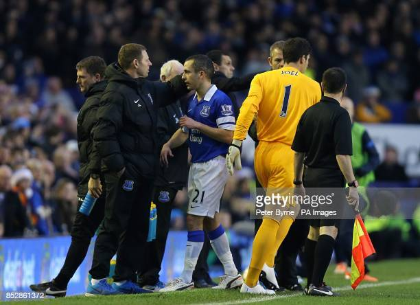 Everton's Leon Osman is met by manager Roberto Martinez after goalkeeper Joel Robles is brought on as his substitute