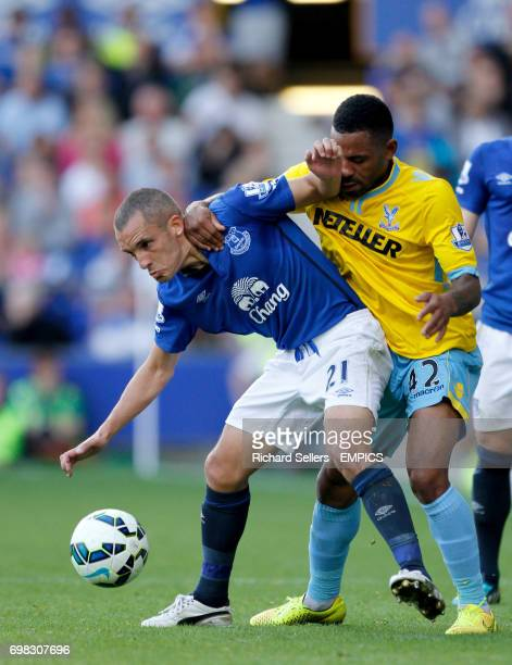 Everton's Leon Osman tussles for possession with Crystal Palace's Jason Puncheon