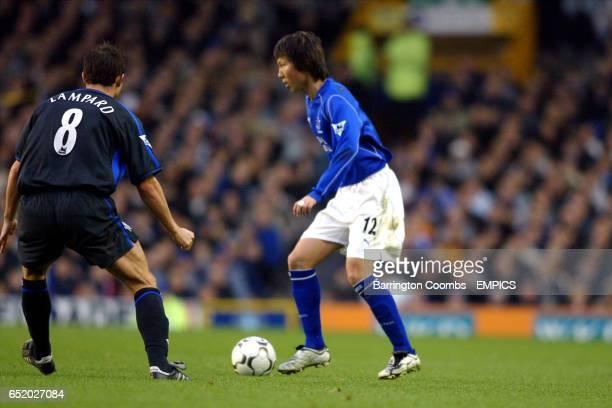 Everton's Li Tie takes on Chelsea's Frank Lampard