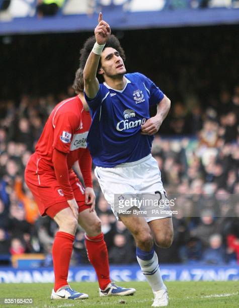 Everton's LMarouane Fellaini celebrates scoring their second goal