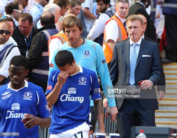 Everton's Louis Saha Tim Cahill goalkeeper Carlo Nash and manager David Moyes dejected after collecting their losers medals