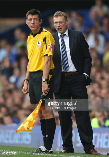 Everton's manager David Moyes has a word in the linesman's ear during the game