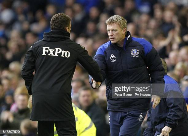 Everton's manager David Moyes shakes hands with stand in Fulham caretaker manager Billy McKinlay