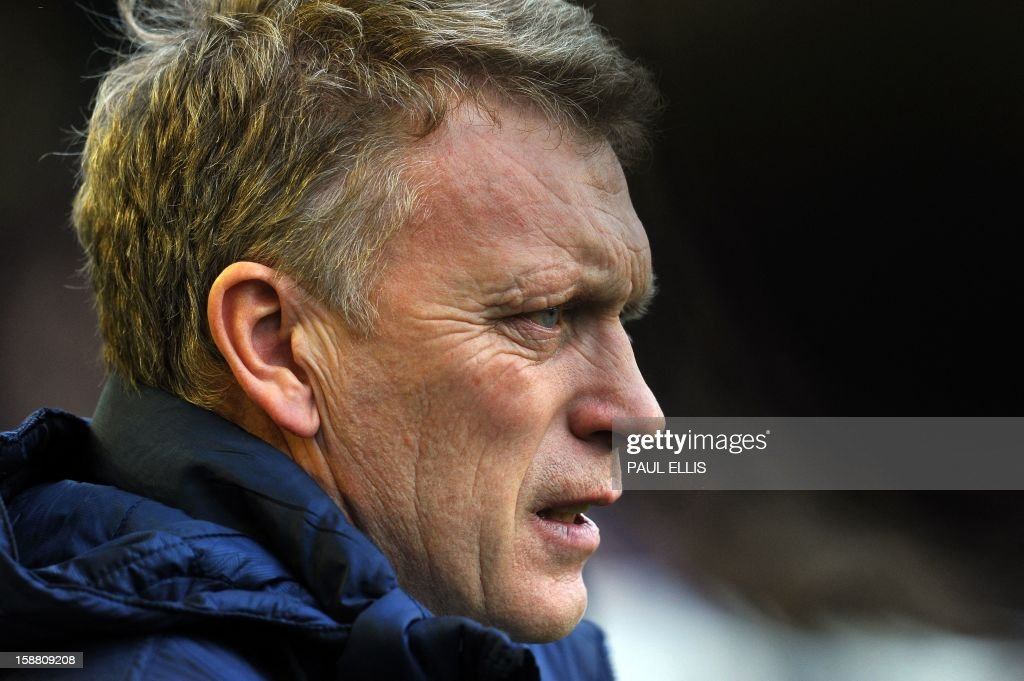 Everton's manager David Moyes waits for kick-off before the start of the English Premier League football match between Everton and Chelsea at Goodison Park in Liverpool, England, on December 30, 2012.