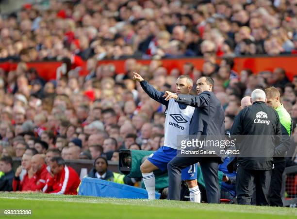Everton's manager Roberto Martinez and Everton's Leon Osman on the touchline