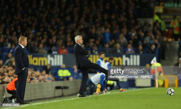 Everton's manager Ronald Koeman watches Crystal Palace's manager Alan Pardew kick the ball back into play