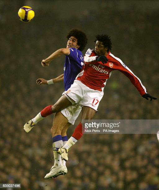 Everton's Marouane Fellaini and Arsenal's Alexandre Song Billong battle for the ball
