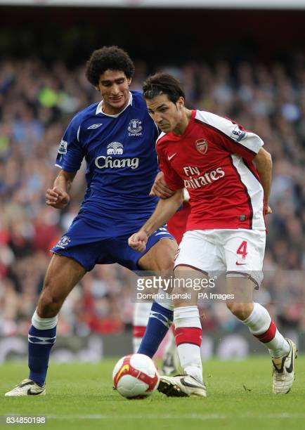 Everton's Marouane Fellaini and Arsenal's Francesc Fabregas battle for the ball