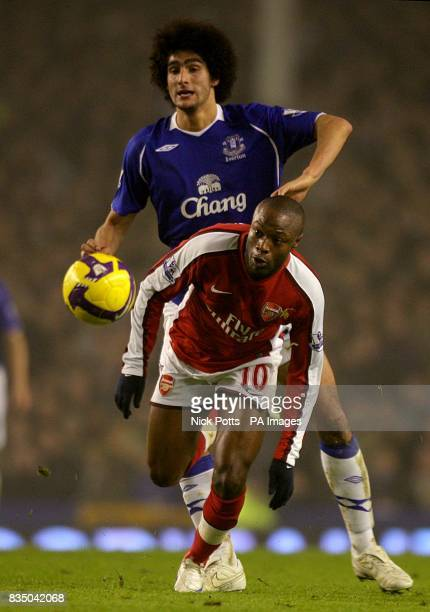 Everton's Marouane Fellaini and Arsenal's William Gallas battle for the ball