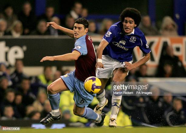 Everton's Marouane Fellaini and Aston Villa's Gareth Barry battle for the ball