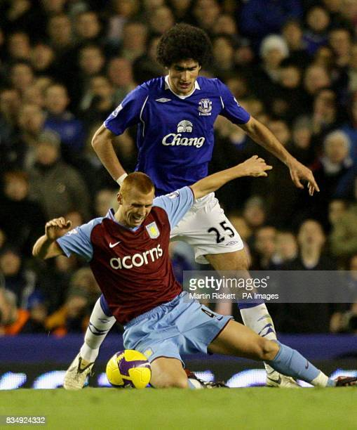 Everton's Marouane Fellaini and Aston Villa's Steve Sidwell battle for the ball