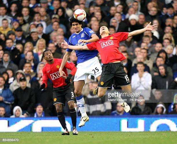 Everton's Marouane Fellaini and Manchester United's Nemanja Vidic battle for the ball