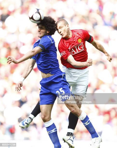 Everton's Marouane Fellaini and Manchester United's Nemanja Vidic in action