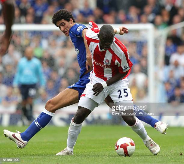 Everton's Marouane Fellaini and Stoke City's Abdoulaye Fay battle for the ball