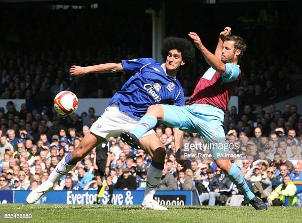 Everton's Marouane Fellaini and West Ham United's Lucas Neill battle for the ball