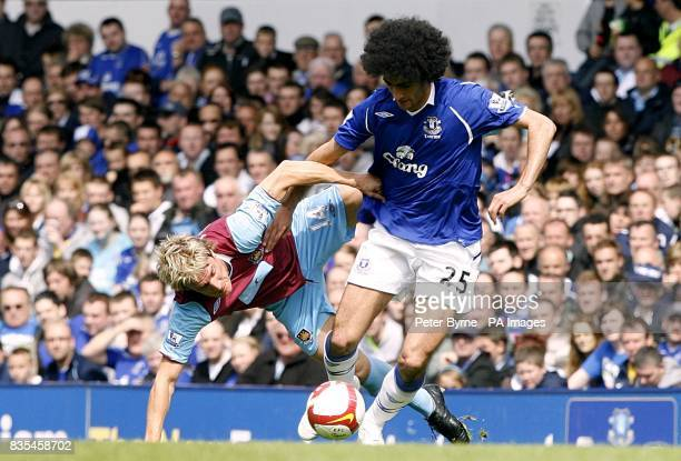 Everton's Marouane Fellaini and West Ham United's Radoslav Kovac battle for the ball