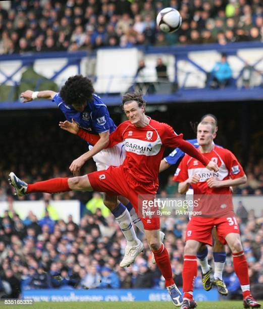 Everton's Marouane Fellaini beats Middlesbrough's Robert Huth to score his team's first of the game