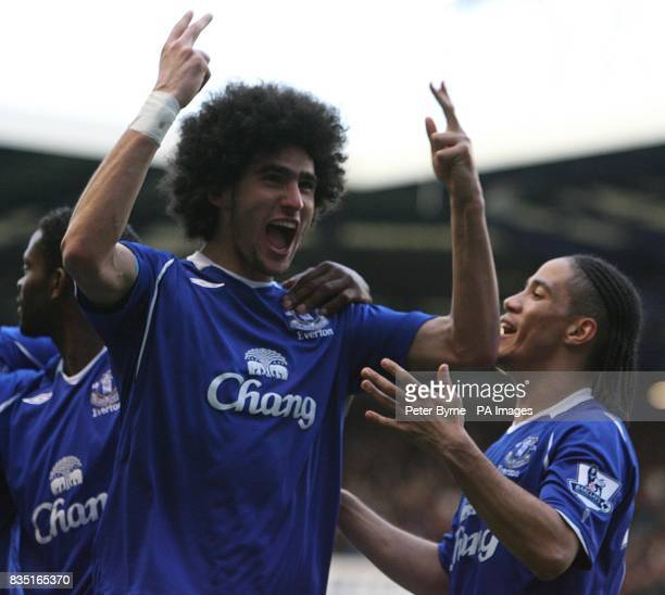 Everton's Marouane Fellaini celebrates scoring their first goal