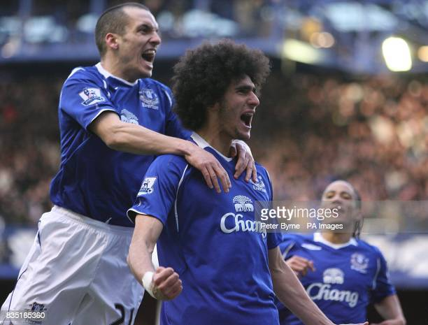 Everton's Marouane Fellaini celebrates scoring their first goal with team mate Leon Osman