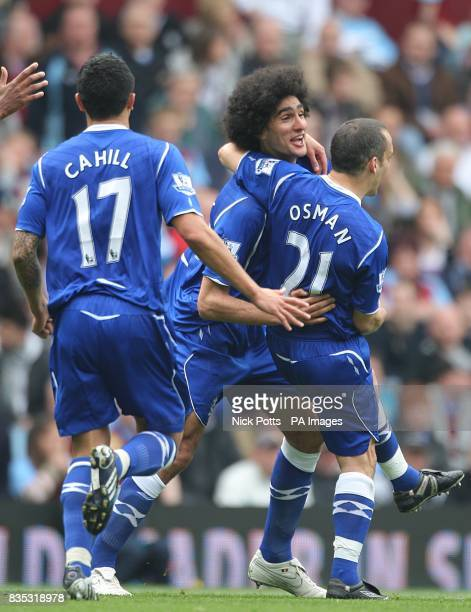Everton's Marouane Fellaini celebrates with his tema mates Tim Cahill and Leon Osman after scoring the first goal