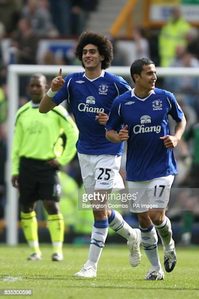Everton's Marouane Fellaini celebrates with teammate Tim Cahill after scoring his sides second goal of the game as Wigan Athletic's Titus Bramble...