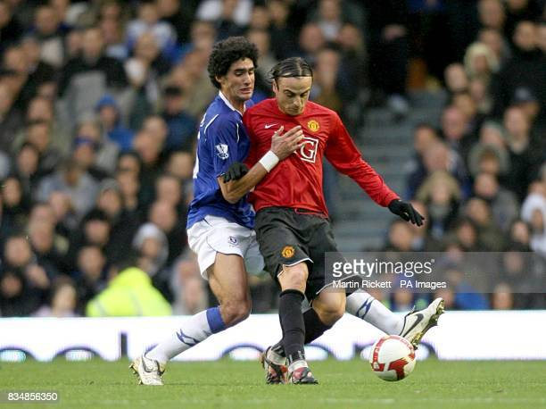 Everton's Marouane Fellaini challenges Manchester United's Dimitar Berbatov for the ball