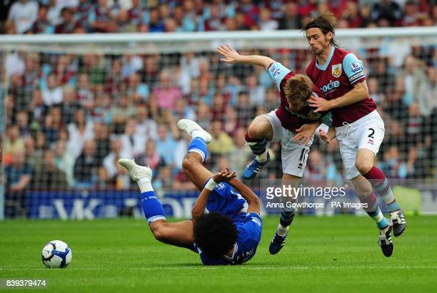Everton's Marouane Fellaini is fouled by Burnley's Wade Elliott and Graham Alexander during the Barclays Premier League match at Turf Moor Burnley