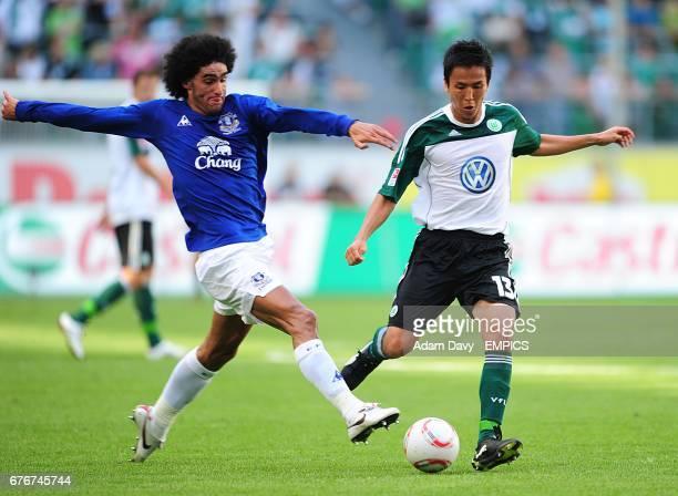 Everton's Marouane Fellaini tackles Vfl Wolfsburg's Makoto Hasebe