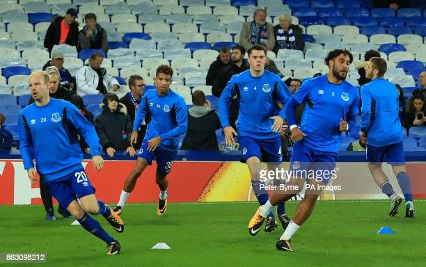 Everton's Mason Holgate warms up alongside teammates during the UEFA Europa League Group E match at Goodison Park Liverpool