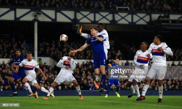 Everton's Michael Keane and Olympique Lyonnais' Mouctar Diakhaby battle for the ball during the UEFA Europa League Group E match at Goodison Park...