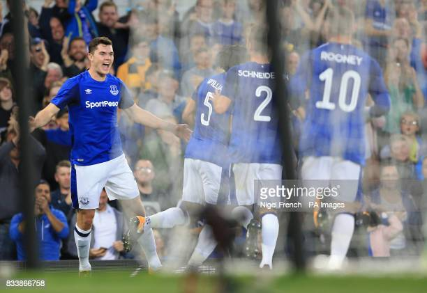 Everton's Michael Keane celebrates scoring his side's first goal of the game during the UEFA Europa League PlayOff First Leg match at Goodison Park...