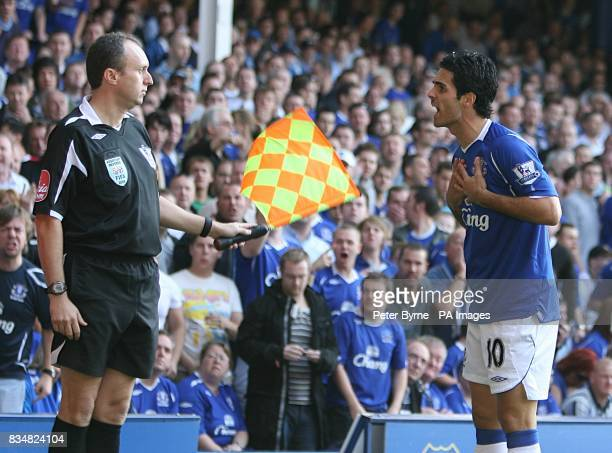 Everton's Mikel Arteta argues with the linesman on the touchline