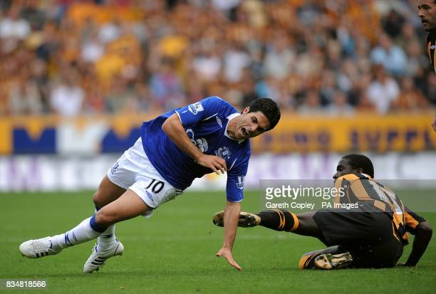 Everton's Mikel Arteta goes to ground after a challenge by Hull City's Bernard Mendy