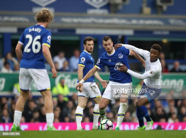 Everton's Morgan Schneiderlin and Leicester City's Demarai Gray battle for the ball during the Premier League match at Goodison Park Liverpool