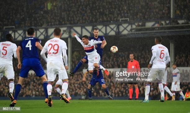 Everton's Morgan Schneiderlin and Olympique Lyonnais' Houssem Aouar battle for the ball during the UEFA Europa League Group E match at Goodison Park...